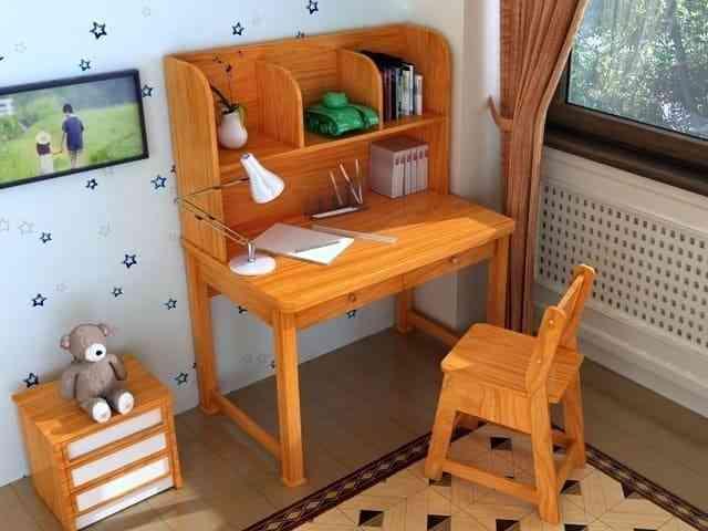 Chiều cao bàn ghế học sinh tiểu học tác động đến bệnh cong vẹo cột sống - ban hoc bang go cao su co nen su dung hay khong 1